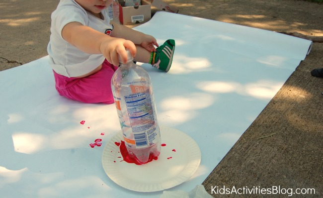 girl making water bottle flowers