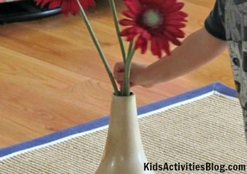 child and flower arranging