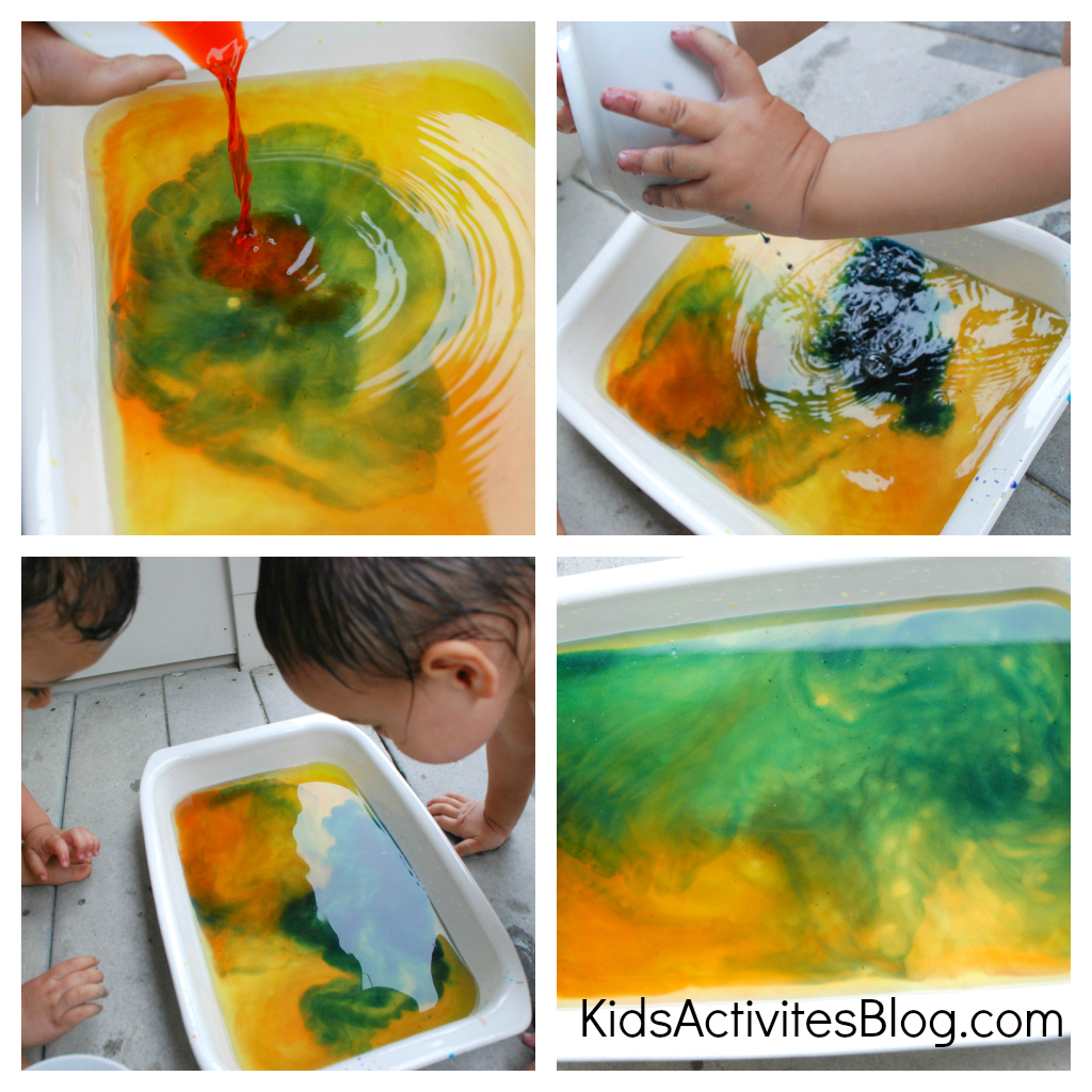Adding red, green, yellow, orange, blue food coloring to water in a bin and then mixing the colors to make a witches brew.