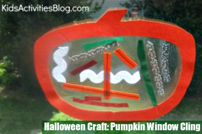 pumpkin window cling with all sorts of stuff inside it like ribbon