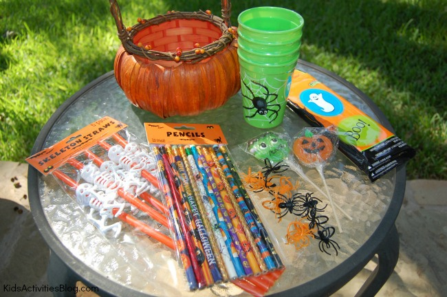 You've been boo'd treats like green halloween cups, plastic spiders, skeleton straws, suckers, and halloween themed pencils.