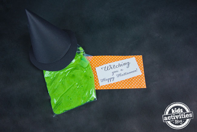 "This is a bag of green ""melted witch"" with an orange and white gift card."