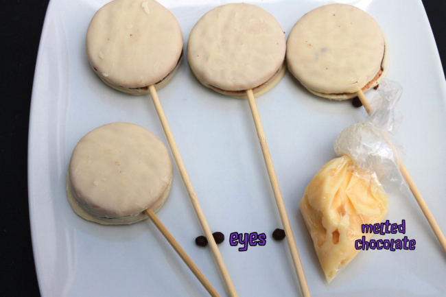 no bake mummy treat for kids for Halloween steps showing snack cakes, melted chocolate in a bag, skewers and mummy eyes