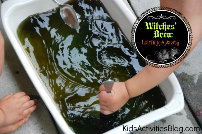 Mixing the witches brew and creating a greenish black color in the water.