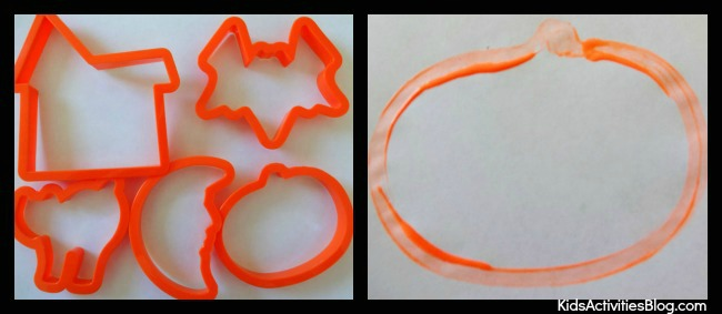 Make Halloween cards using cookie cutters as stencils - this one is a pumpkin example