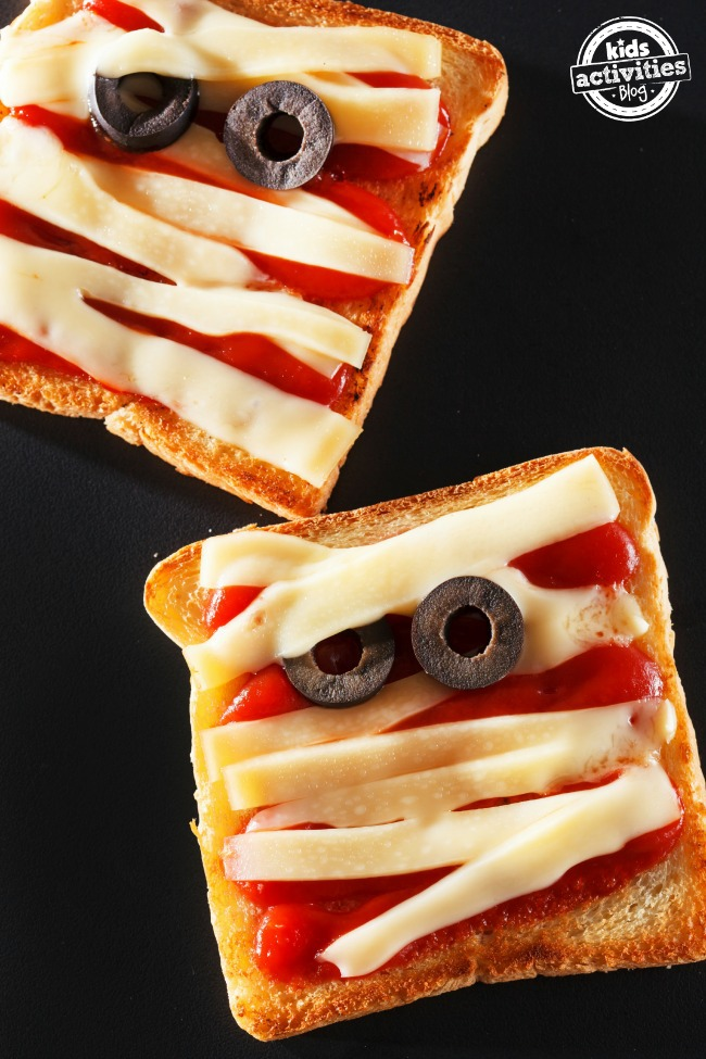 spooky mummy sandwiches with cheese and olives