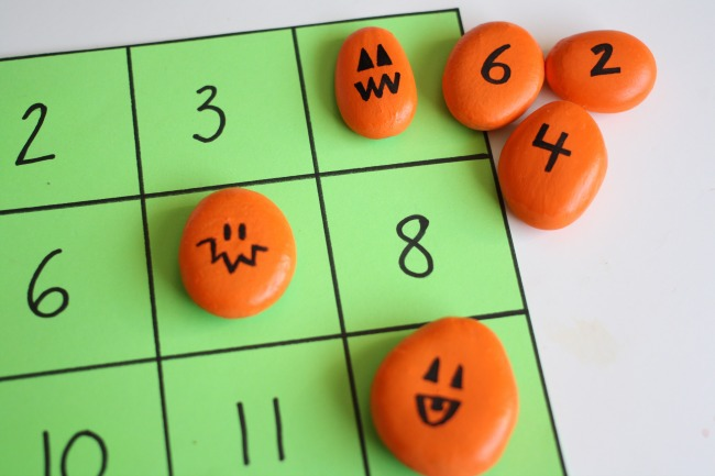 Painted pumpkins math game with number squares 1-12