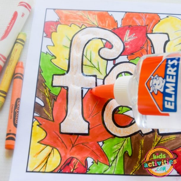 Using glue and seeds on fall coloring pages