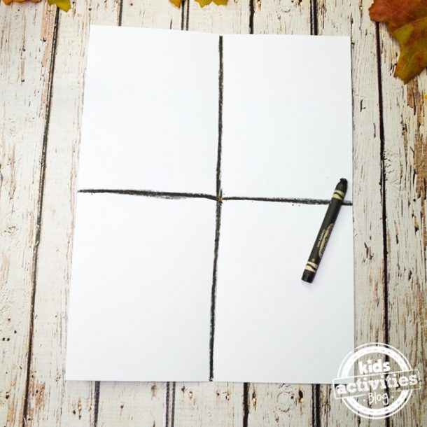 Take your white paper and use a black crayon to break it up in fours to begin this fall art project for toddlers.