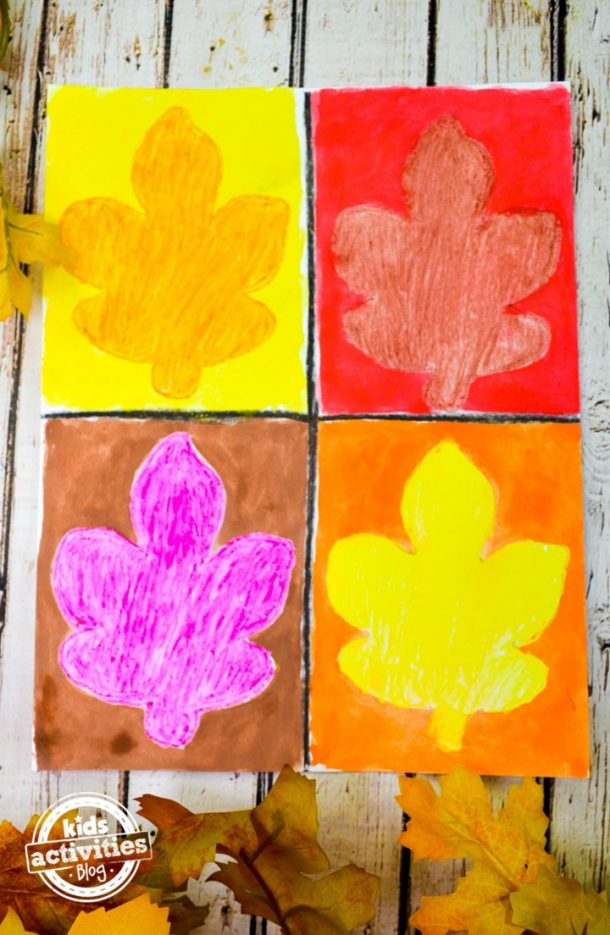 The orange leaf has a yellow background, the red leaf has a red background, the purple leaf has a brown background, and the yellow leaf has an orange background making this fall leaf art project beautiful.