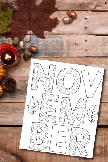November coloring sheet against a wooden background