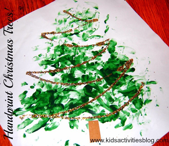 our handprint Christmas tree with green handprints and glitter