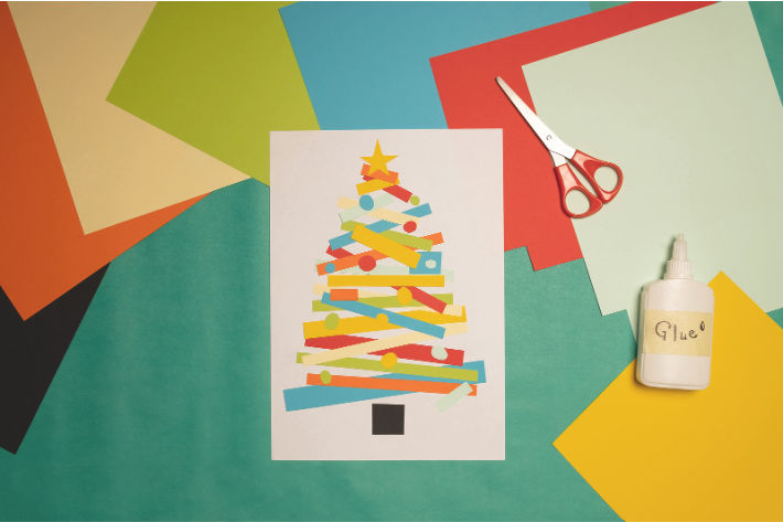 Paper Christmas tree craft made out of strips of colored paper - Kids Activities Blog