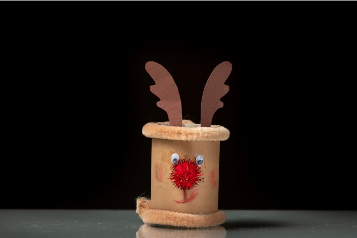 Toilet Paper roll reindeer craft on black background