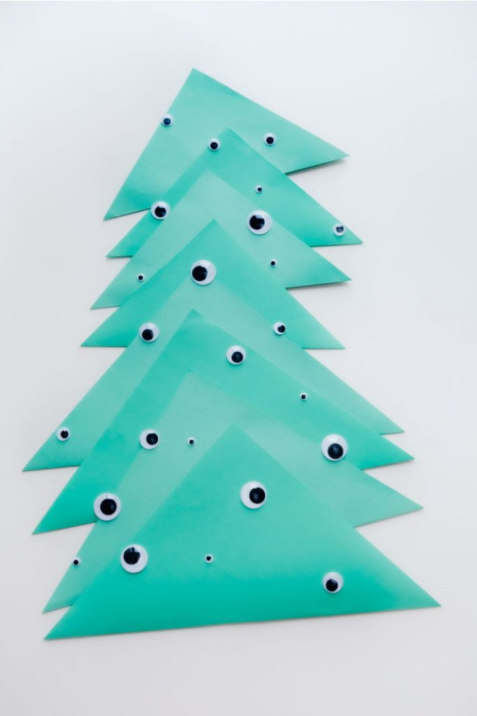 Funny Christmas tree made from paper and decorated with googly eyes