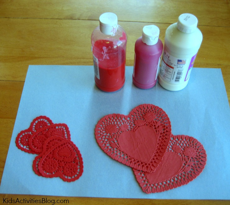 Printmaking with heart doilies makes a fun and easy valentine craft for kids