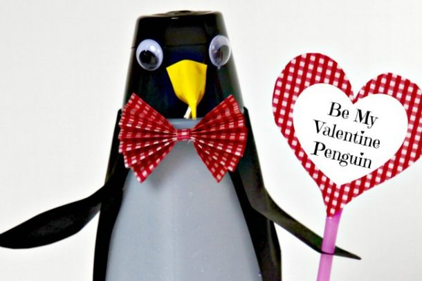 Valentine's day crafts for preschoolers using an International delight bottle that you put black paper, googly eyes, yellow paper as a beak, with a red and white bow tie, holding a pink straw with a white and red heart saying be my valentine penguin.
