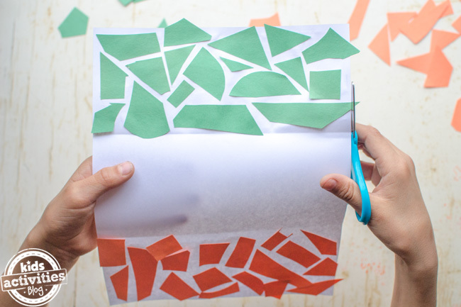 Irish flag craft for kids - final step to trim the edges with scissors