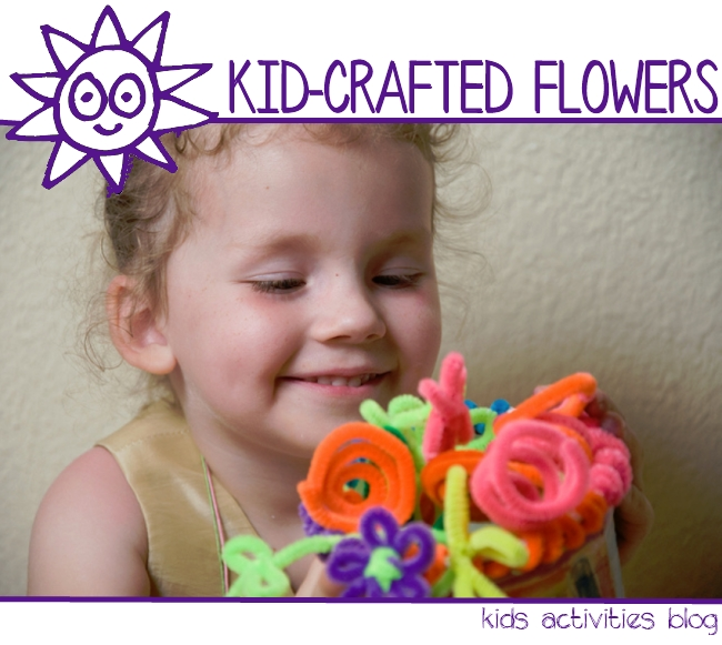 Easy pipe cleaner flowers craft for kids - girl holding a pipe cleaner flower bouquet she made