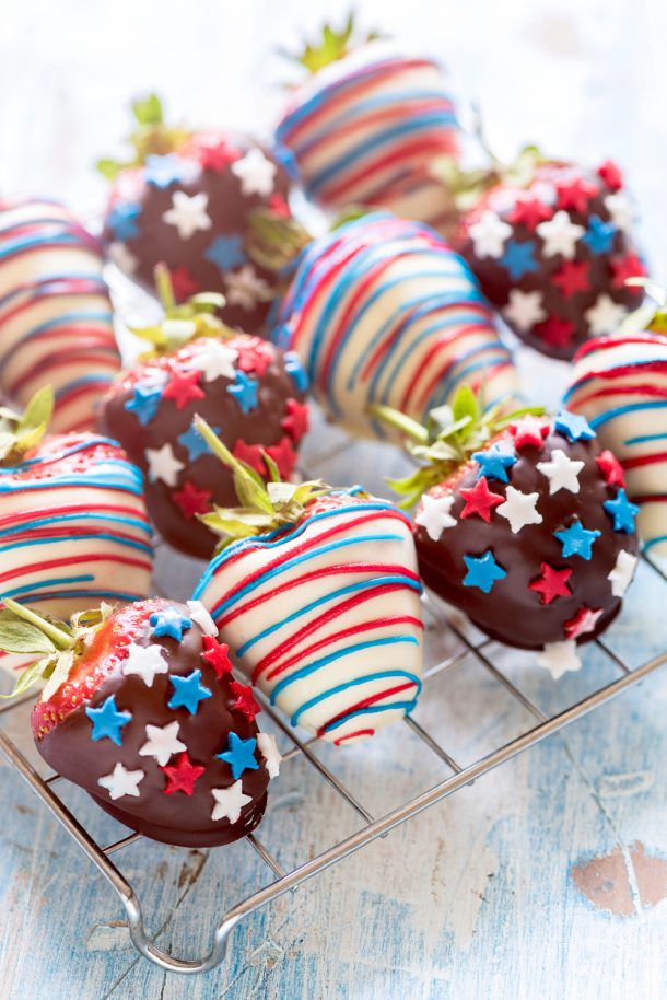 4th of July chocolate covered strawberries with red white and blue decorations