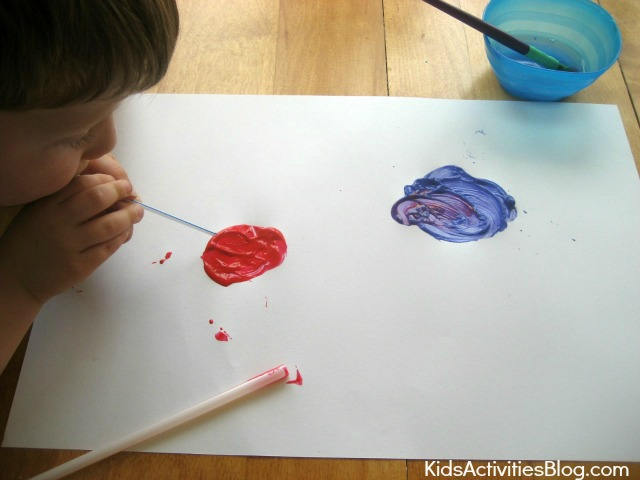 Kids love painting fireworks for 4th of July {straw painting}
