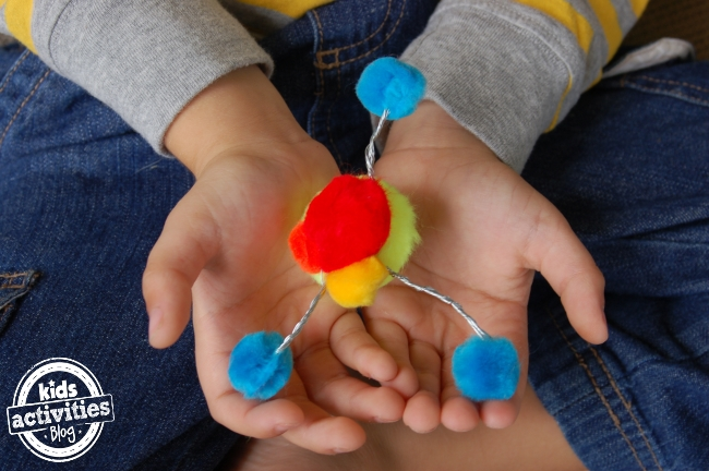build a model atom with pom-poms and wire