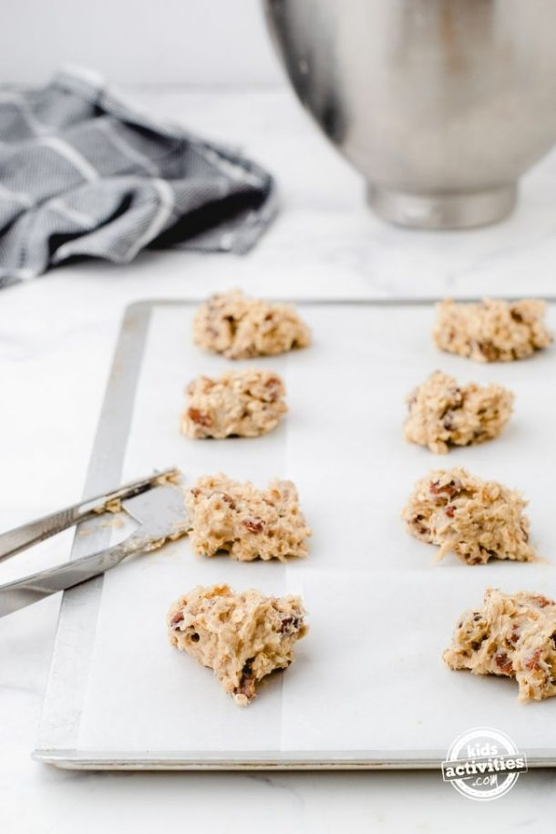 Drop oatmeal cookies on a parchment lined cookie sheet.