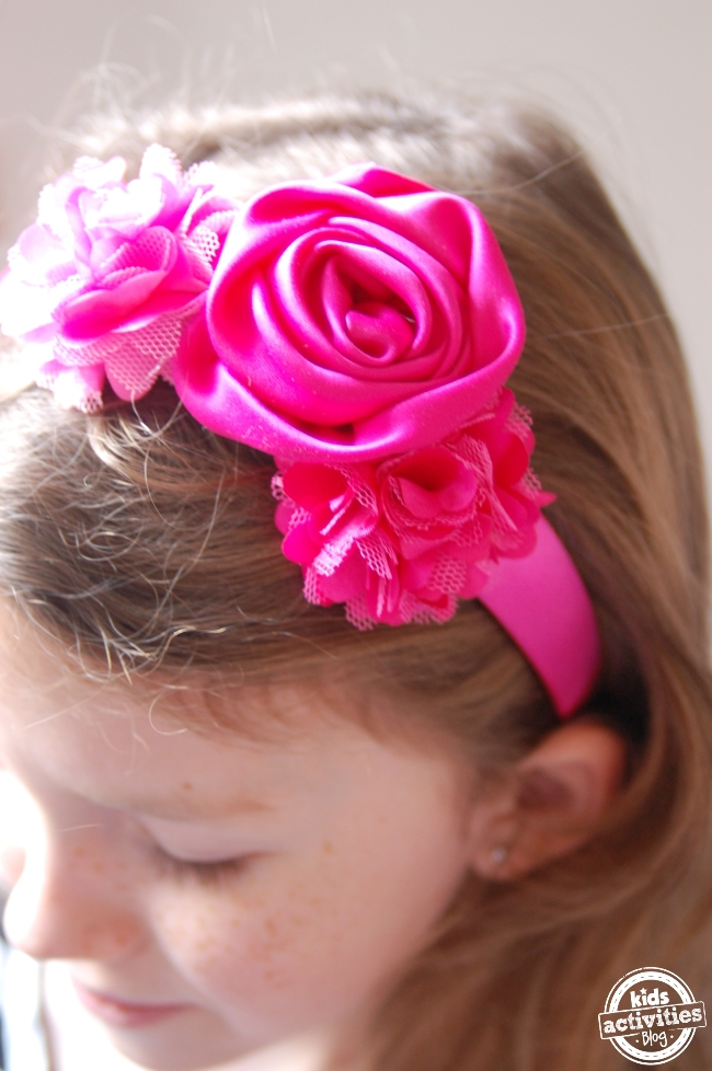 DIY Headband Tutorial for kids - finished mix and match headband system shown with three beautiful pink ribbon flowers