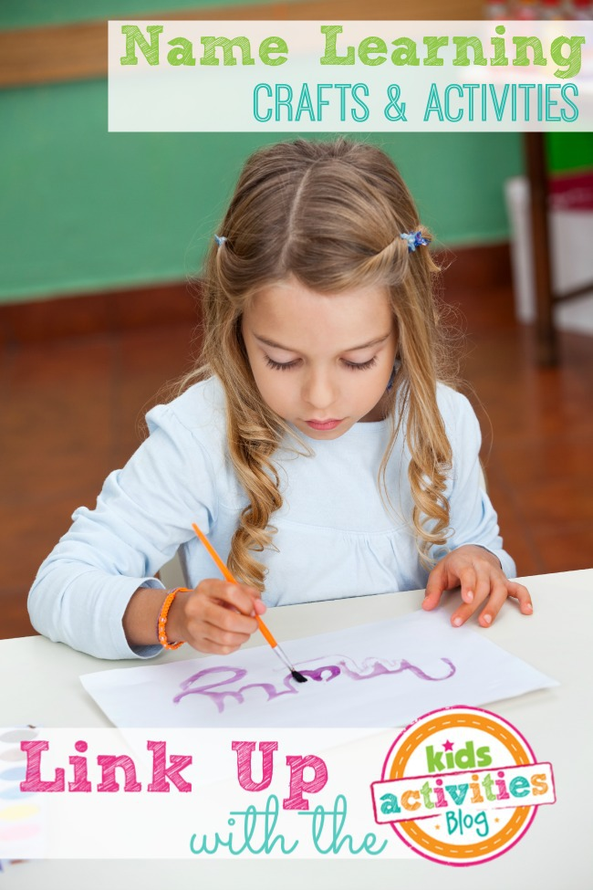 Girl Painting Name On Paper At Desk
