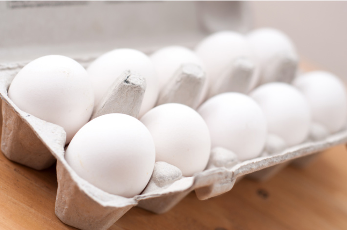 Boiled eggs in an egg carton ready for dyeing for Easter eggs - Kids Activities Blog