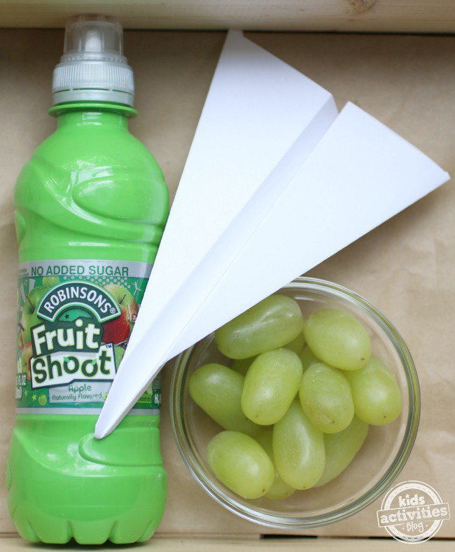 Fruit Shoot - snack - grapes and a paper airplane