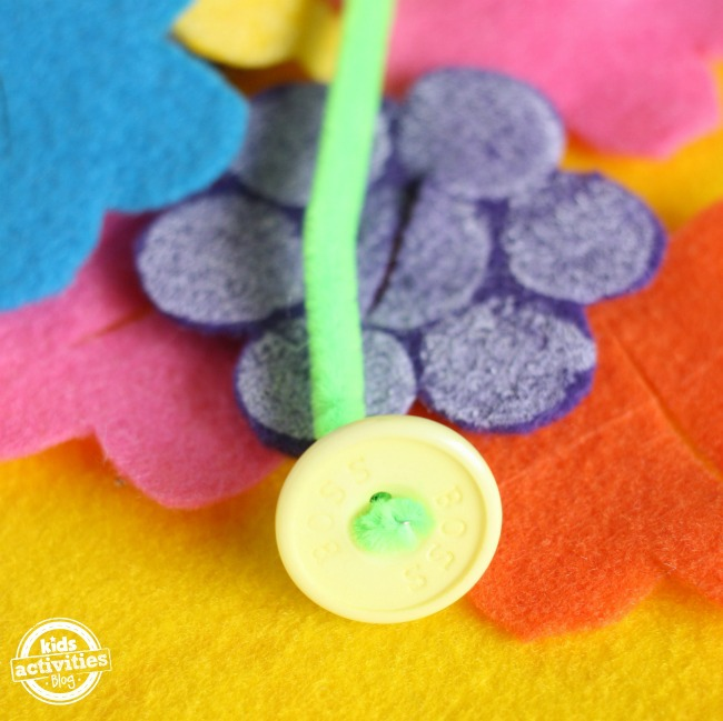 button, pipecleaner and felt flowers