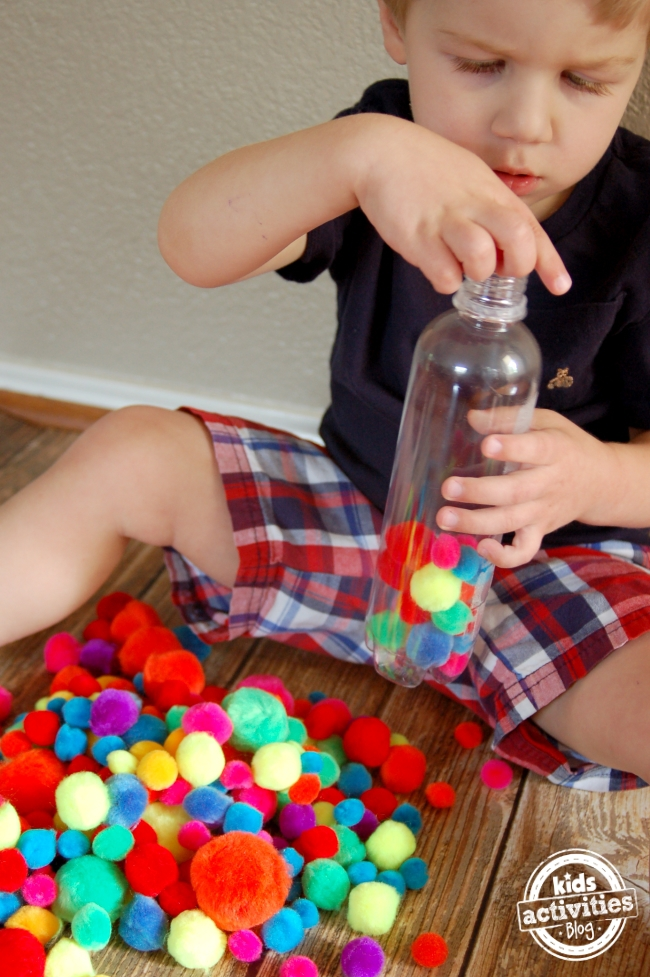 fine motor play with a pompom bottle 2