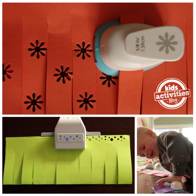 Paper punch making flowers and big and little circles on a orange and green paper lantern.