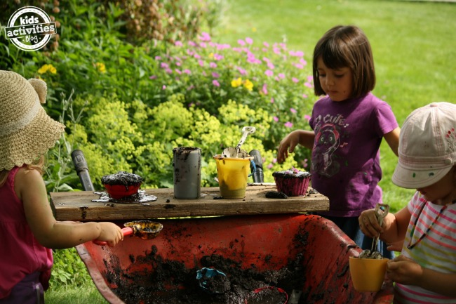 kids playing with mobile mud kitchen