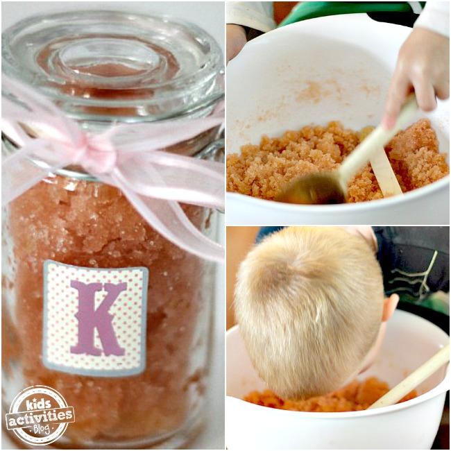 DIY sugar scrub you can make with your kids and put in a little food coloring, lavender oil, and put in a jar with a bow. You can see the little boy stirring the sugar scrub in a white bowl with a spoon and smelling the lavender.