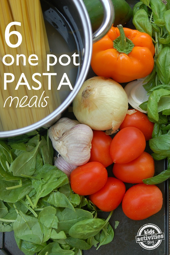 6 one-pot pasta recipes quick and easy - pasta in pasta pot with vegetables like spinach tomatoes peppers and onions