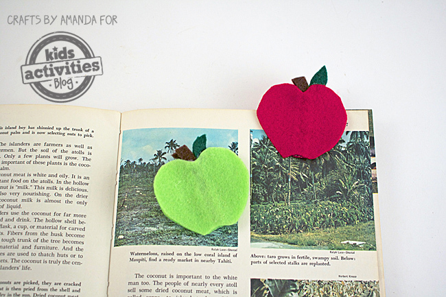 Supplies needed to make a green apple and red apple bookmark.
