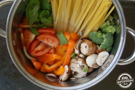pot rainbow veggie pasta - veggies in the water with the pasta before cooking