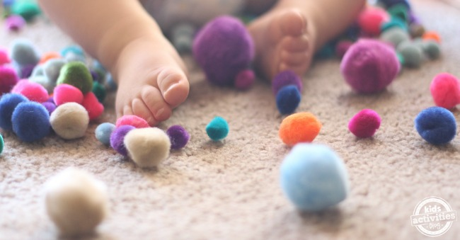 Simple 1 year old activities with pom poms
