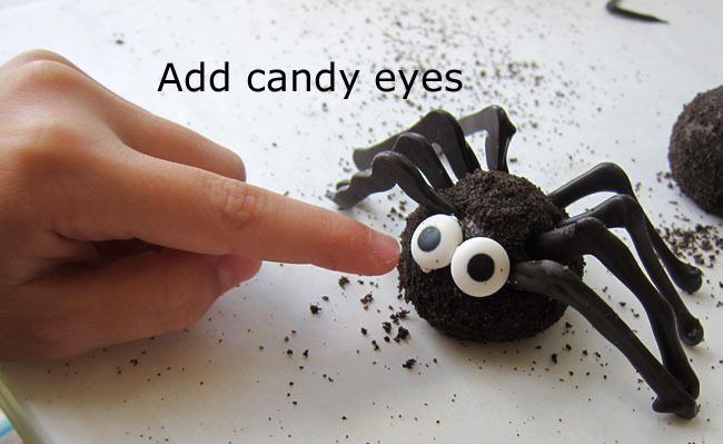 Add candy eyes to your truffle Oreo Spiders