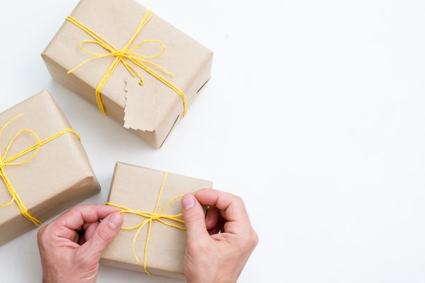 Mail brown paper packages with yellow strings and fill them with fun gifts