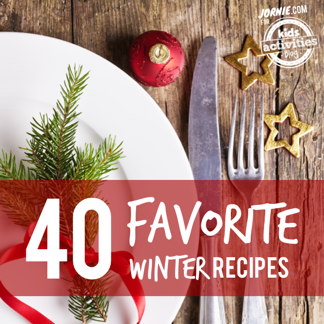 40 Favorite Winter Recipes - plate and silverware next to stars on wood