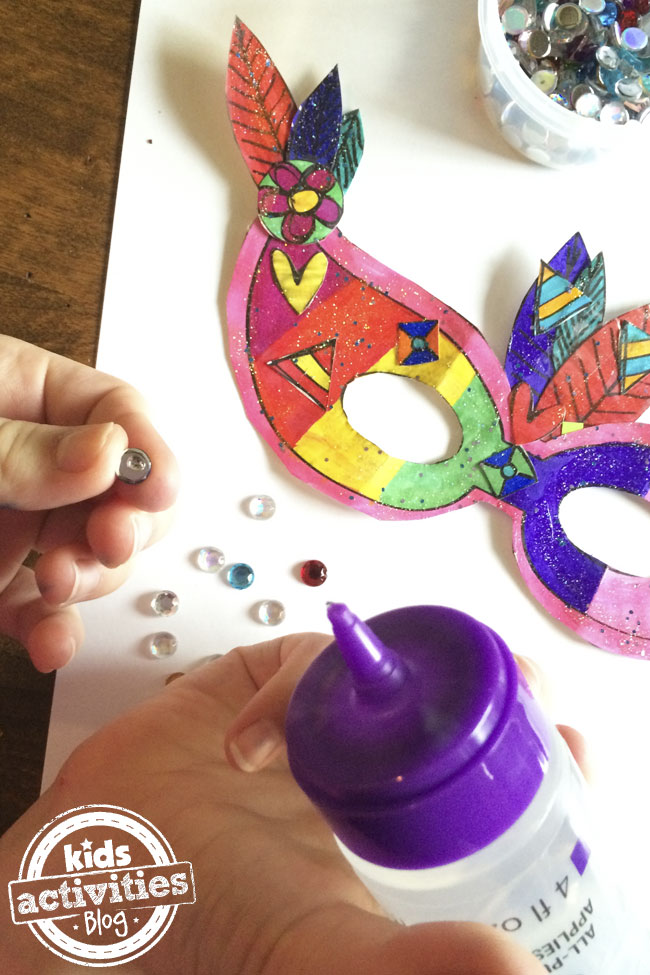 Decorate your own Mardi Gras Mask with glue, and fake gems.