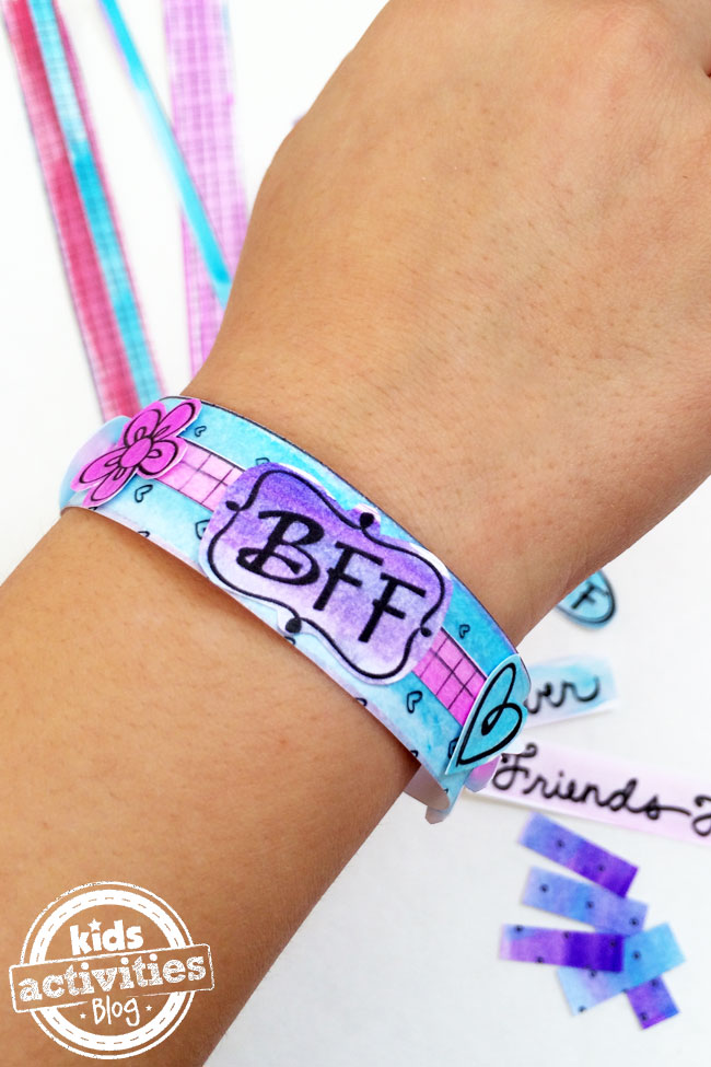 BFF Bracelets Printable finished and worn on girls wrist with BFF badge, flowers hearts and blue pink purple coloring