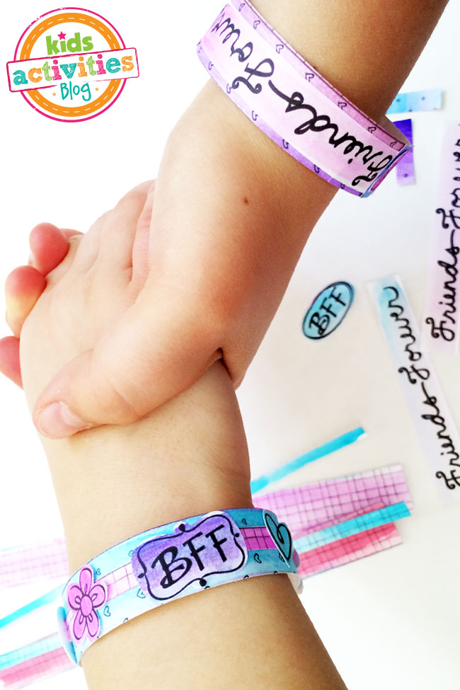 BFF Bracelets Printable - printed paper bracelets painted and colored with markers shown on best friends wrists
