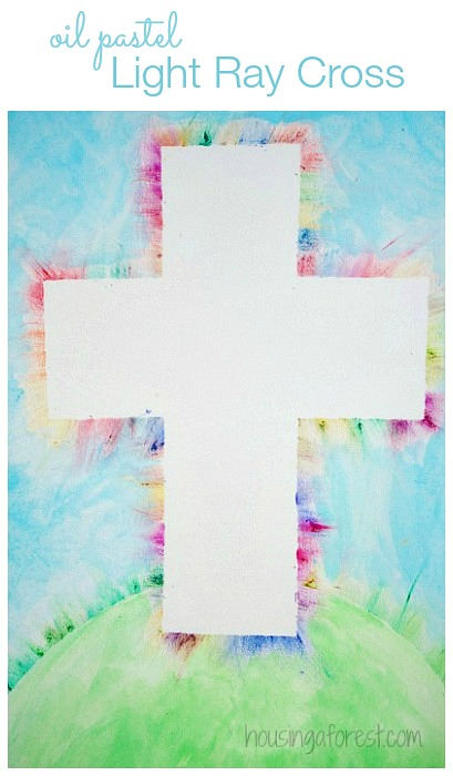 Cross Art using oil pastels to create a rainbow edge around a white outline of a cross.