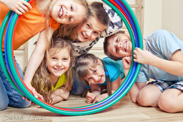 bigstock-Five-cheerful-kids-looking-thr-47188822