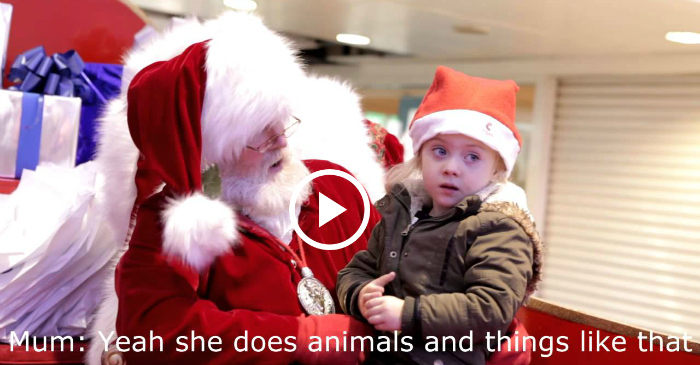santa signs with little girl