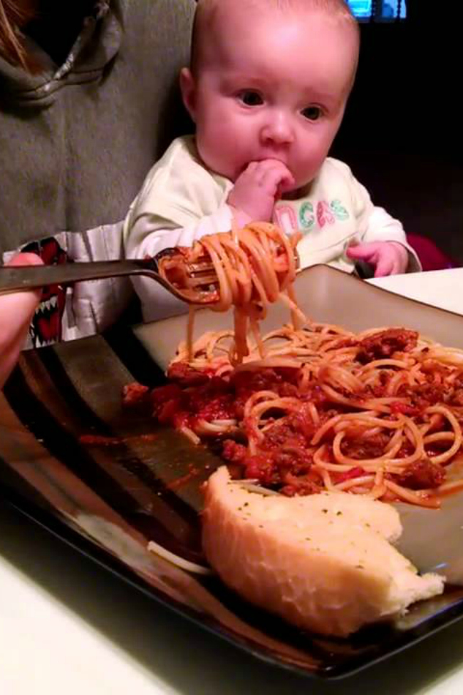 This baby girl DEMANDS spaghetti Right Now!